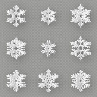 Conjunto de nueve copos de nieve de papel diferentes cortadas de papel sobre fondo transparente.