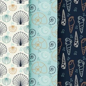 Conjunto de patrones de concha sin costura de diseño plano