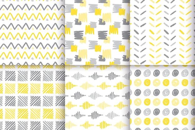 Conjunto de patrones dibujados a mano amarillo y gris