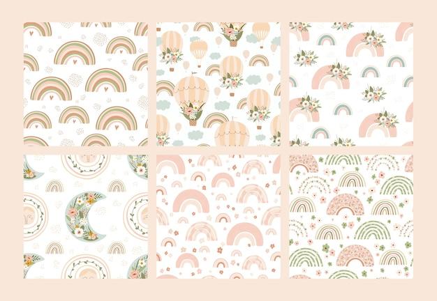 Conjunto de patrones sin fisuras con arco iris, globos de aire, soles, lunas, pájaros y flores en colores pastel