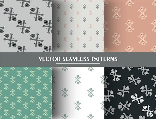 Conjunto de patrones sin fisuras con calaveras y huesos. colección de adornos de terror.