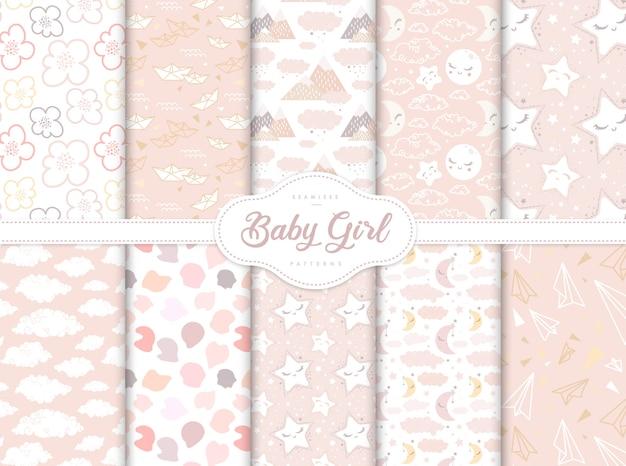 Conjunto de patrones sin fisuras de color rosa para la pequeña guardería de niña bebé
