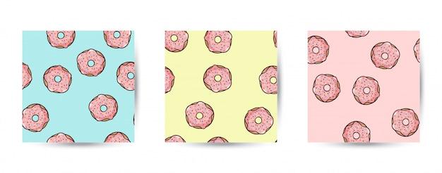Conjunto de patrones sin fisuras donut. rosquillas rosadas con aderezo en color pastel.