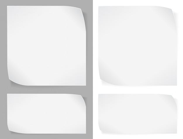 Conjunto de pegatinas de papel blanco sobre gris y blanco.