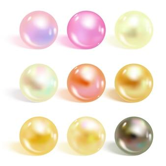 Conjunto de perlas realistas de diferentes colores.
