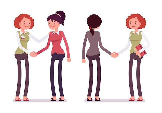 Conjunto de personajes femeninos en un apretón de manos de ropa casual