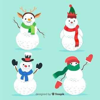 Conjunto de personajes de muñeco de nieve en estilo dibujado a mano