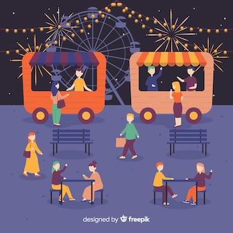 Conjunto de personas en la feria de la noche.