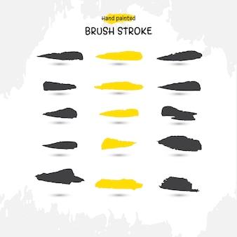 Conjunto de pinceladas de acuarela hechas a mano en negro y amarillo