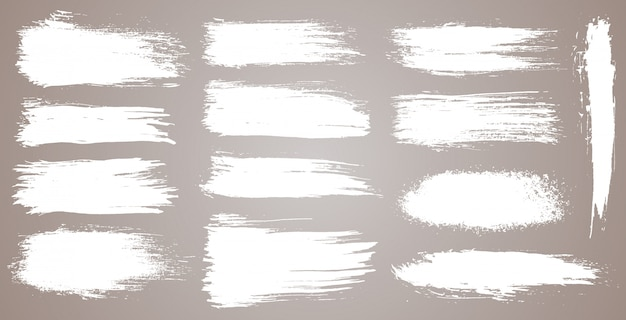 Conjunto de pinceladas artísticas grunge, pinceles. elementos de diseño creativo. trazos de pincel ancho acuarela grunge. colección blanca aislada sobre fondo blanco