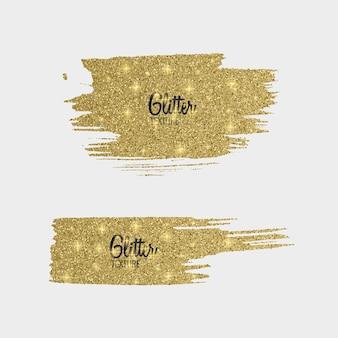 Conjunto de pinceles de brillo dorado aislado en blanco