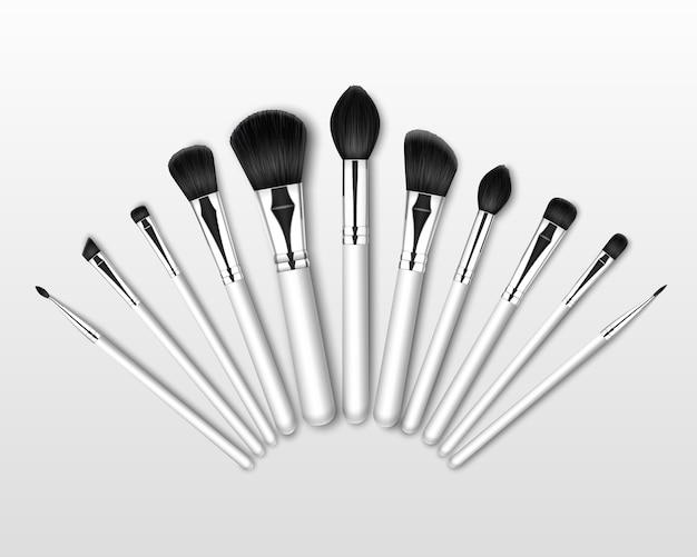 Conjunto de pinceles para cejas de sombra de ojos en polvo corrector de maquillaje profesional negro limpio con asas blancas aisladas