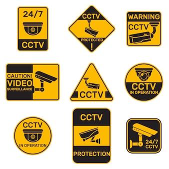 Conjunto plano de diferentes insignias de sistema de cctv.