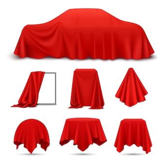 Conjunto realista de objetos cubiertos de tela de seda roja con cortina de mantel de servilleta colgante de marco drapeado