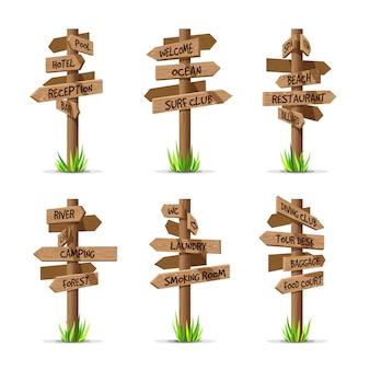 Conjunto de resort de letreros de flecha de madera. concepto de poste de señal de madera con césped.