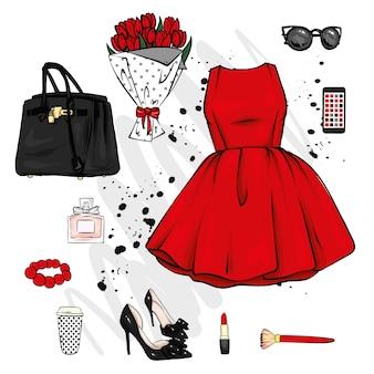 Un conjunto de ropa y accesorios elegantes para mujeres.
