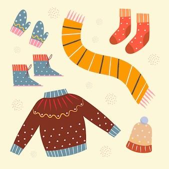 Conjunto de ropa de invierno acogedora dibujada y elementos esenciales.