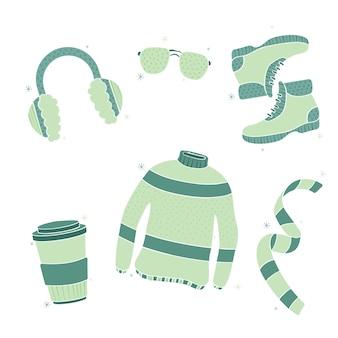Conjunto de ropa de invierno cálido dibujado a mano
