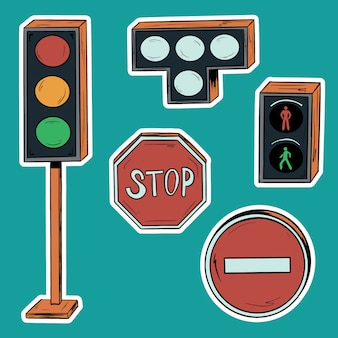 Un conjunto de semáforos y letreros facetados en la carretera.