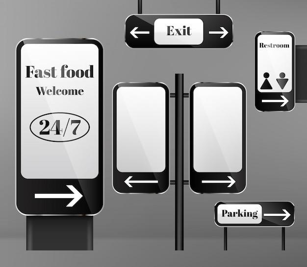 Conjunto de señales de calle en postes metálicos, señales de dirección con flechas aisladas sobre fondo.