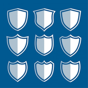 Conjunto de signos y símbolos de escudo blanco.