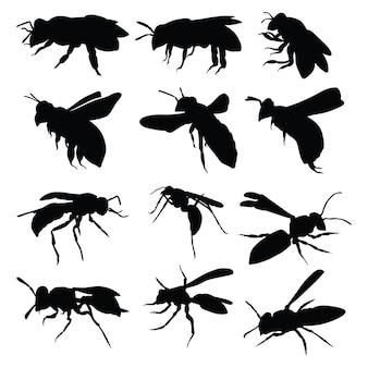 Conjunto de silueta de insectos voladores de abeja y avispa