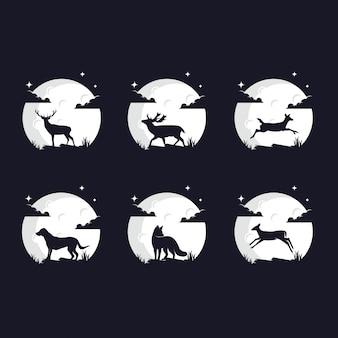 Conjunto de siluetas de animales contra la luna