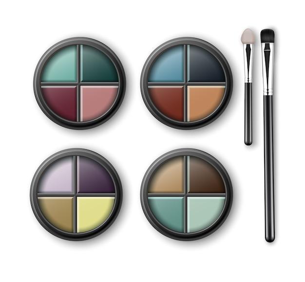Conjunto de sombras de ojos multicolores azul claro rosa marrón violeta amarillo turquesa verde ocre en estuche de plástico transparente negro redondo con aplicadores de pinceles de maquillaje aislado en el fondo.