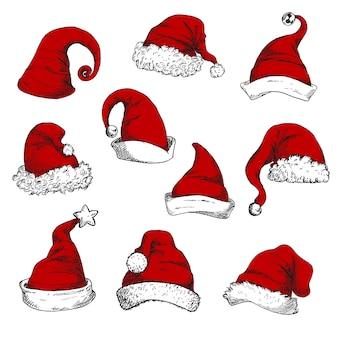 Conjunto de sombreros rojos de santa. elementos de decoración de navidad y año nuevo.