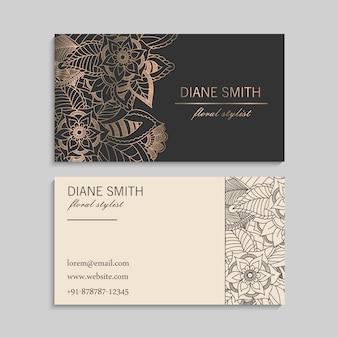Conjunto de tarjeta de visita con flores dibujadas a mano zentangle.