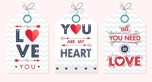 Conjunto de tarjetas creativas para el día de san valentín. letras dibujadas a mano con corazones, flechas y fondos en zigzag.