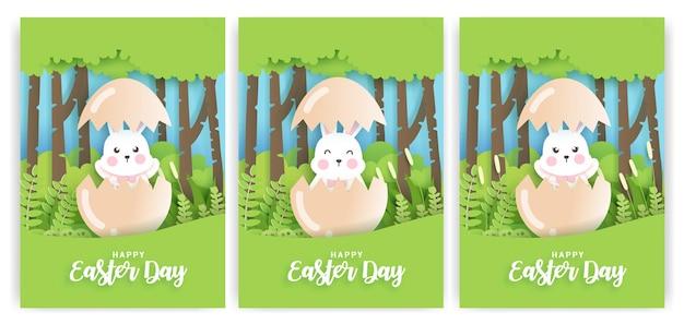 Conjunto de tarjetas del día de pascua con lindo conejo en estilo de corte de papel.