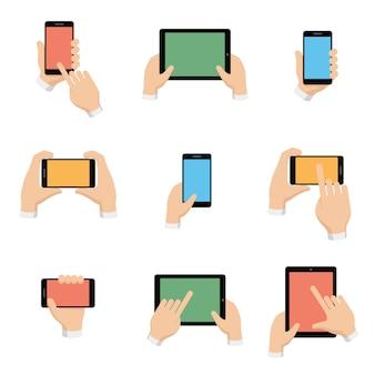 Conjunto de teléfono inteligente y tableta en manos en estilo de diseño plano.
