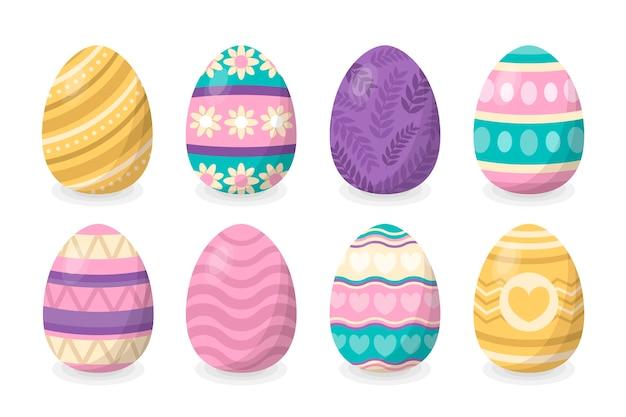 Conjunto tradicional de huevos de pascua aislado sobre fondo blanco.