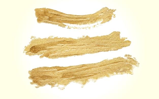 Conjunto de trazos de pincel dorado hecho a mano