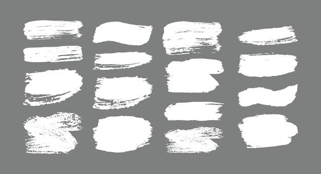 Conjunto de trazos de pincel. elementos de diseño grunge. pintura dorada, tinta, pinceles, líneas, grungy. cajas artísticas sucias, marcos. líneas de oro aisladas. ilustración de arte con textura brillante oro abstracto.