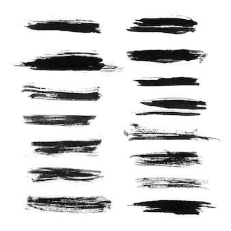 Conjunto de trazos de pincel grunge negro aislado sobre fondo blanco.