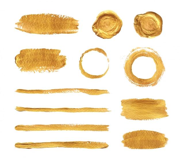 Conjunto de trazos de pincel de pintura dorada.