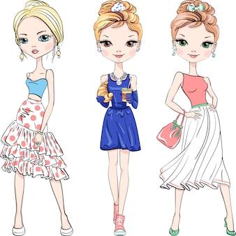 Conjunto de tres hermosas chicas de moda top model en vestidos de verano