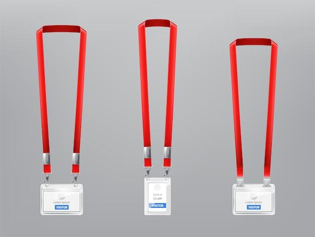 Conjunto con tres insignias de plástico realistas, titulares con clips metálicos y cordones rojos