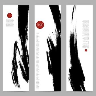 Conjunto de tres pancartas verticales con manchas de tinta a pincel.