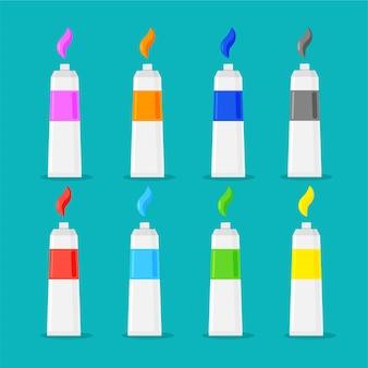 Conjunto de tubos de pintura de colores con trazos de muestra y sombras.
