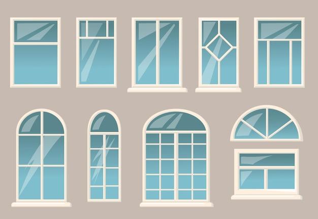 Conjunto de varias ventanas. diferentes marcos y vasos sobre fondo de pared de edificio gris.