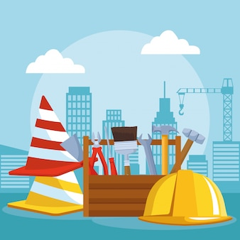 Conos de tráfico con caja de herramientas y casco de seguridad sobre el escenario en construcción