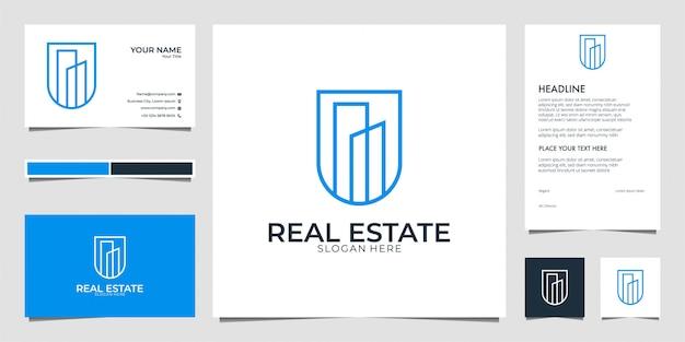 Construcción de bienes raíces con tarjeta de visita y membrete de diseño de logotipo de estilo de arte lineal