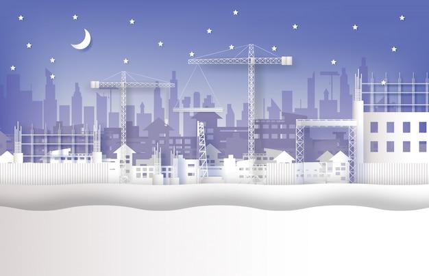 En construcción y grúas en la ciudad.