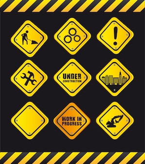En construcción y señal de tráfico de precaución