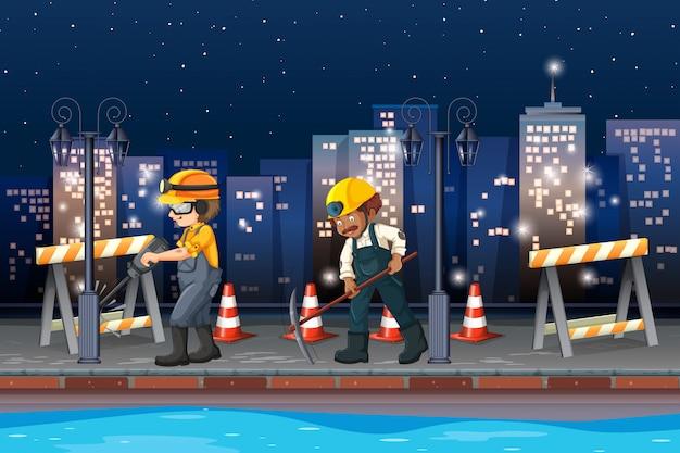 Construcción trabajando por la noche
