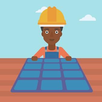 Constructor con panel solar.