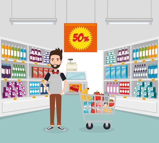 Consumidor con carrito de compras de comestibles